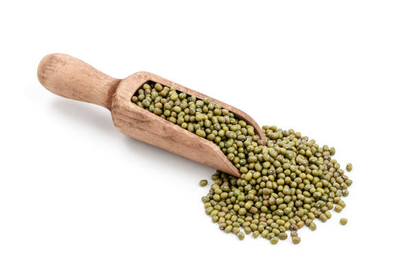 Mung beans in a serving scoop shot on white background stock photo