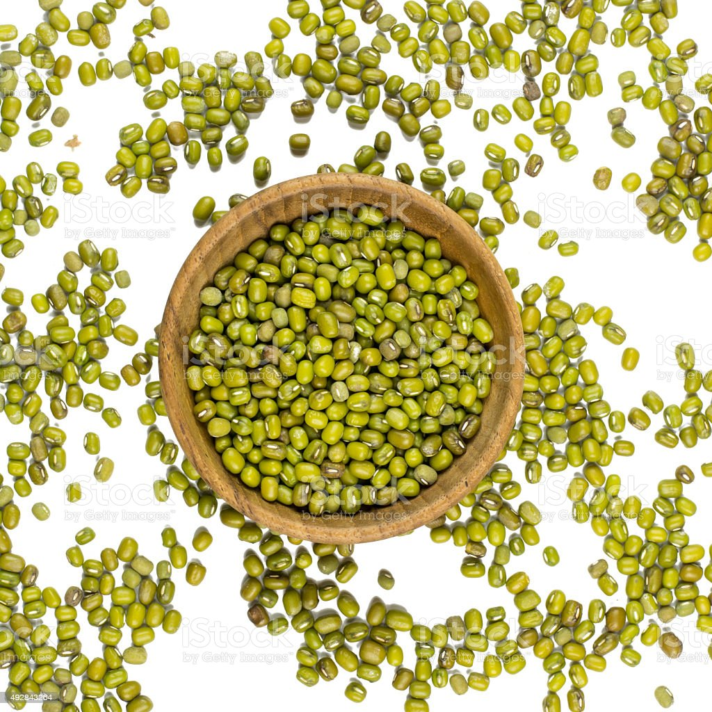 mung beans in and out bowl isolated on white background stock photo