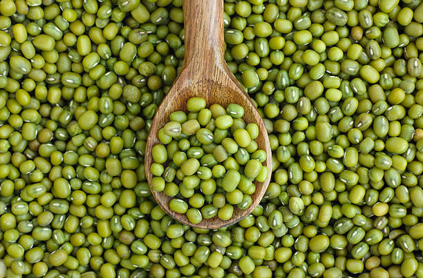 Mung beans (mash) in wooden spoon stock photo