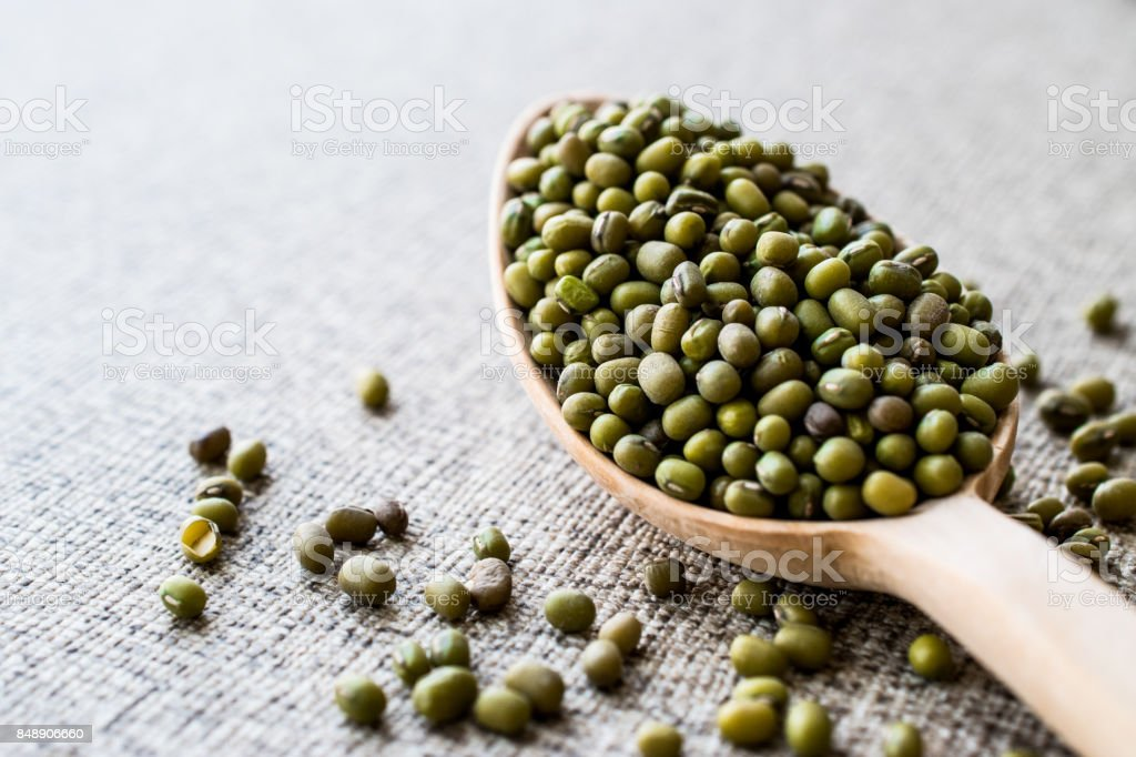 Mung Beans in wooden spoon. stock photo