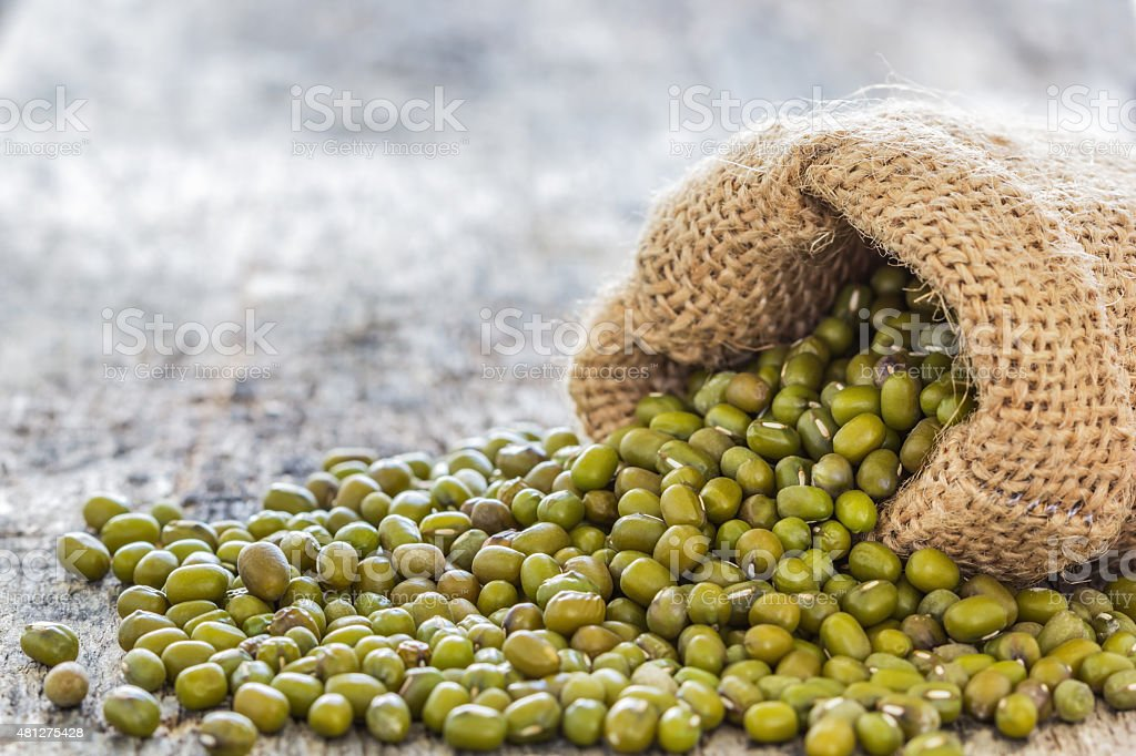 Mung beans poured from the sack stock photo