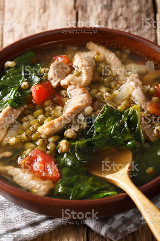Munggo Guisado Filipino soup of beans mung closeup in a bowl. Vertical stock photo