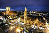 High angle view of Marienplatz, The New Town Hall (Neues Rathaus) and Frauenkirche at night in Munich, Germany.