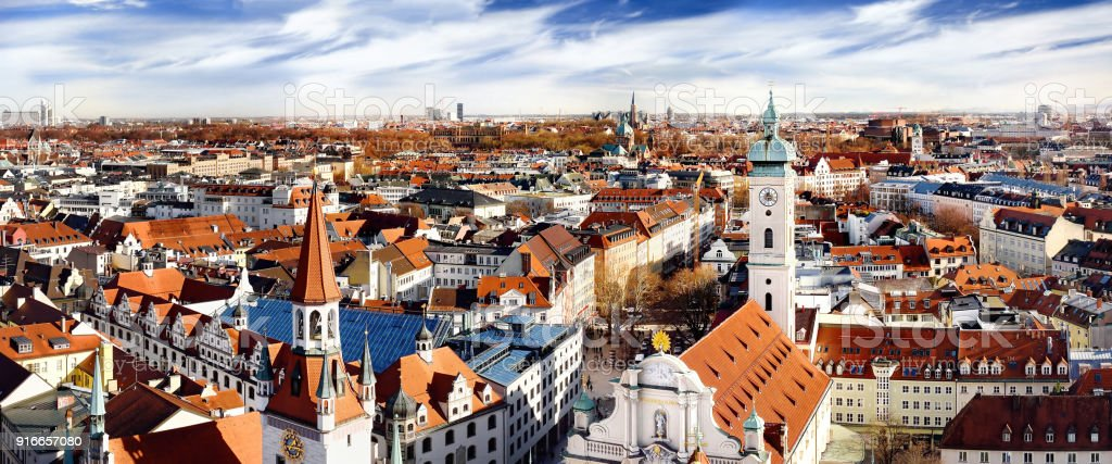 Munich center panoramic cityscape view with Old Town Hall and Heiliggeistkirche stock photo