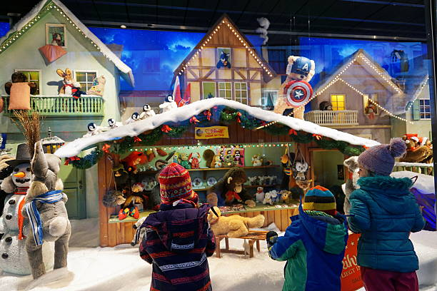 Munich Christmas time. Children admire the shop window's stuffed toys. stock photo