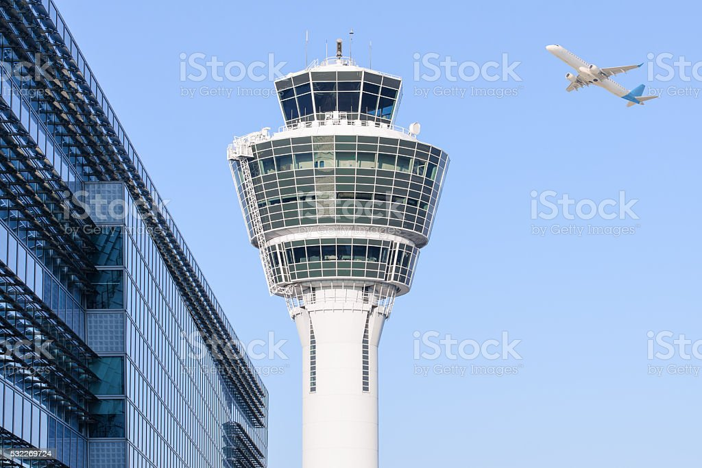 Munich international airport control tower and departing taking off stock photo