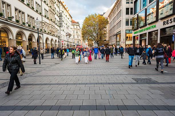 munich pedestrian zone with some hare krishna dancers - fußgängerzone stock-fotos und bilder