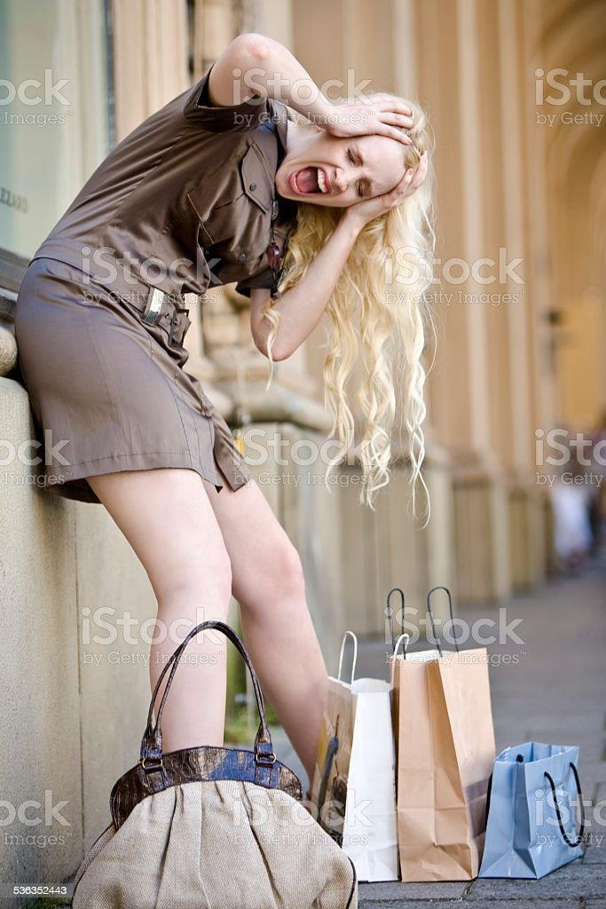 Munich, Young woman with shopping bags freaking out stock photo