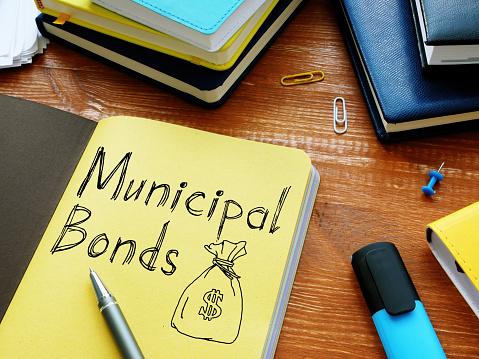 Municipal bonds is shown on a conceptual business photo