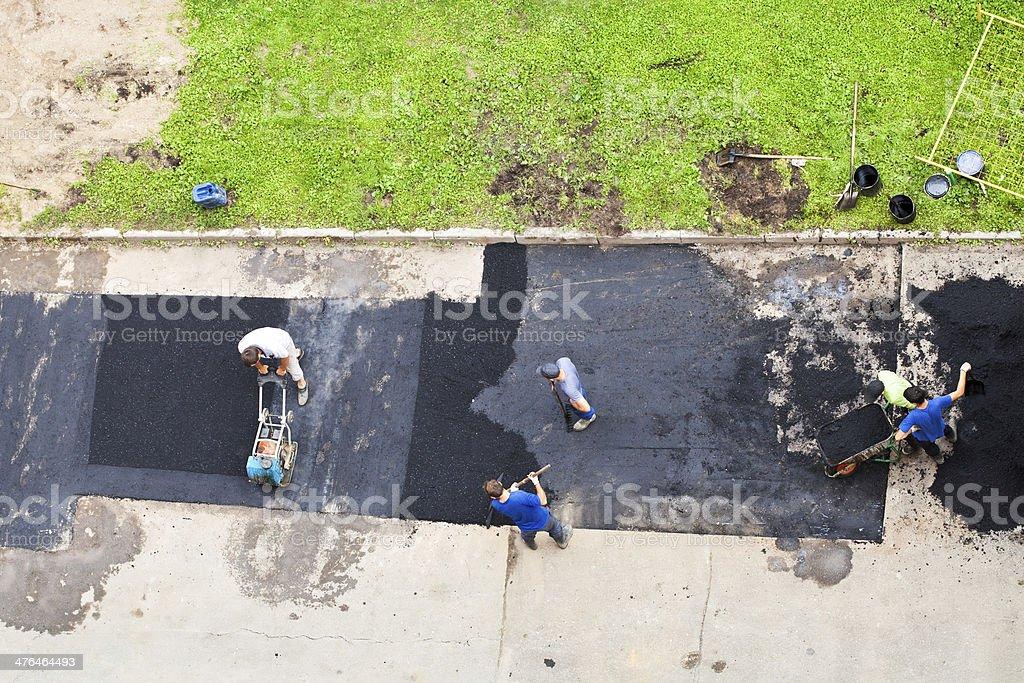 municipal roadmen laid asphalt stock photo