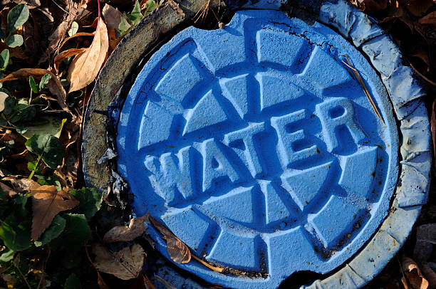 Municipal Urban City Utility Infrastructure; Blue Water Main Cap stock photo