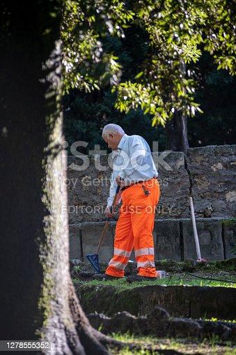 terni,itali october 05 2020:municipality employee gardening in a public park