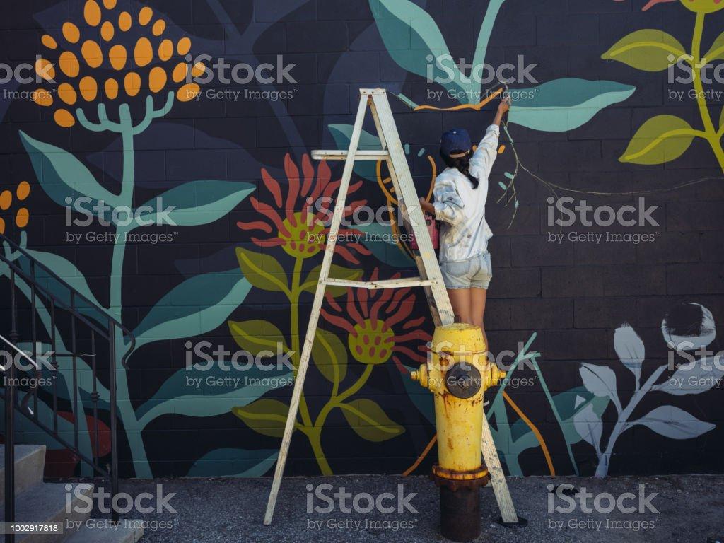 Mural artist at work stock photo