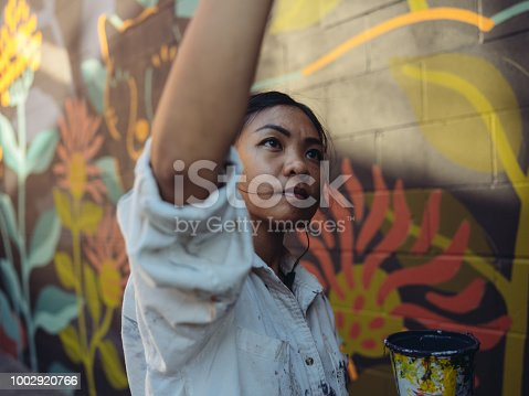 1002918466 istock photo Mural artist at work 1002920766