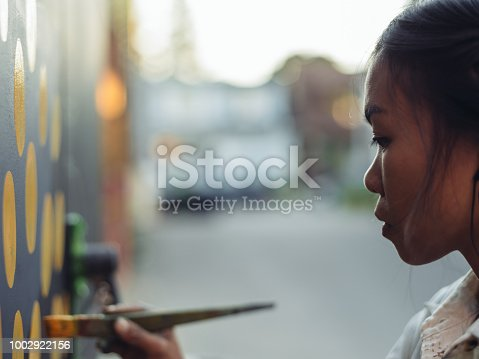 1002918466 istock photo Mural artist at work 1002922156