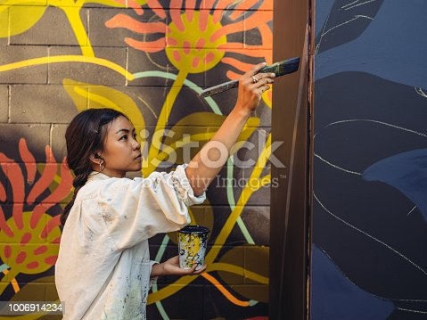 1002918466 istock photo Mural artist at work 1006914234