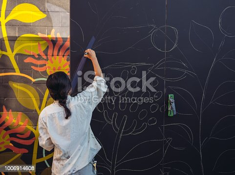 1002918466 istock photo Mural artist at work 1006914608