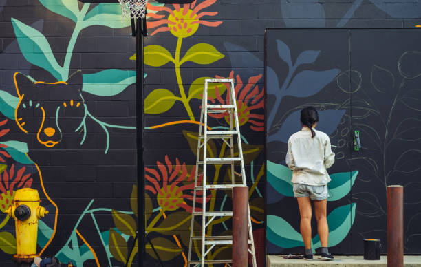 Mural artist at work stock photo