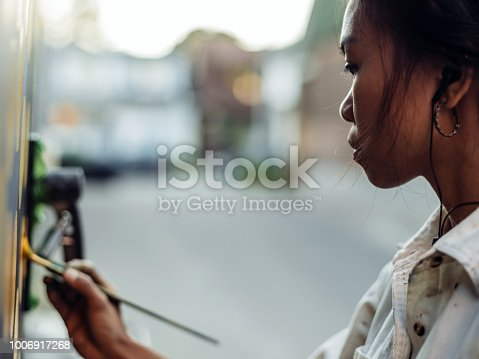 1002918466 istock photo Mural artist at work 1006917268