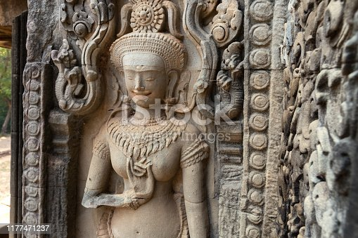 1147569123 istock photo Mural of the woman Apsara on wall Angkor Wat temple complex, close up 1177471237