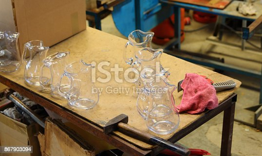Murano glass vases and tools. Glassworks process. Blowing glass.
