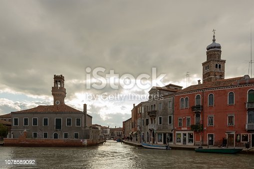 Murano Island - part of Venice, ancient architecture on the background of the canal.
