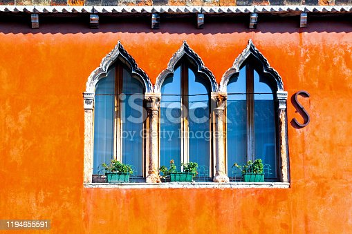 Old windows on the Murano colorful house
