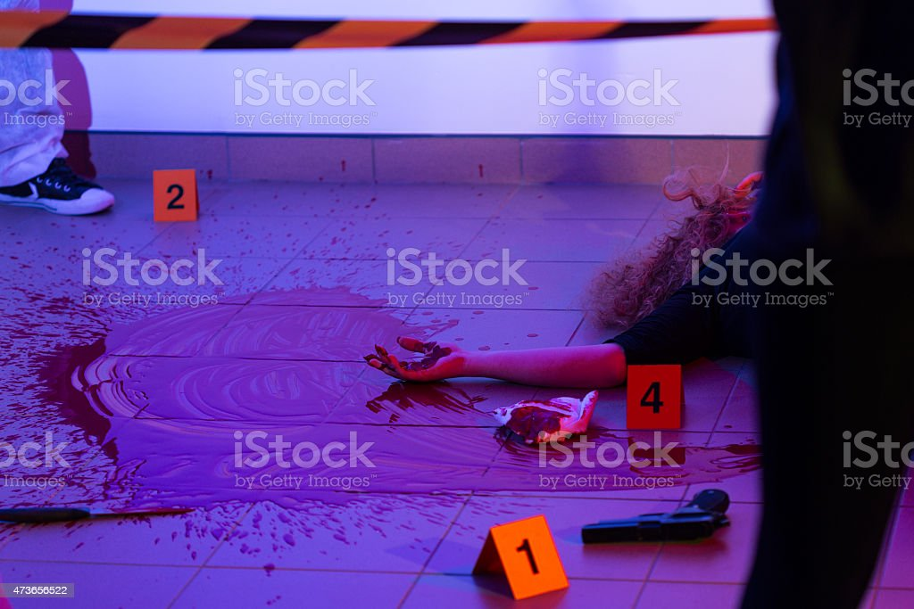 Murder scene with killed woman stock photo