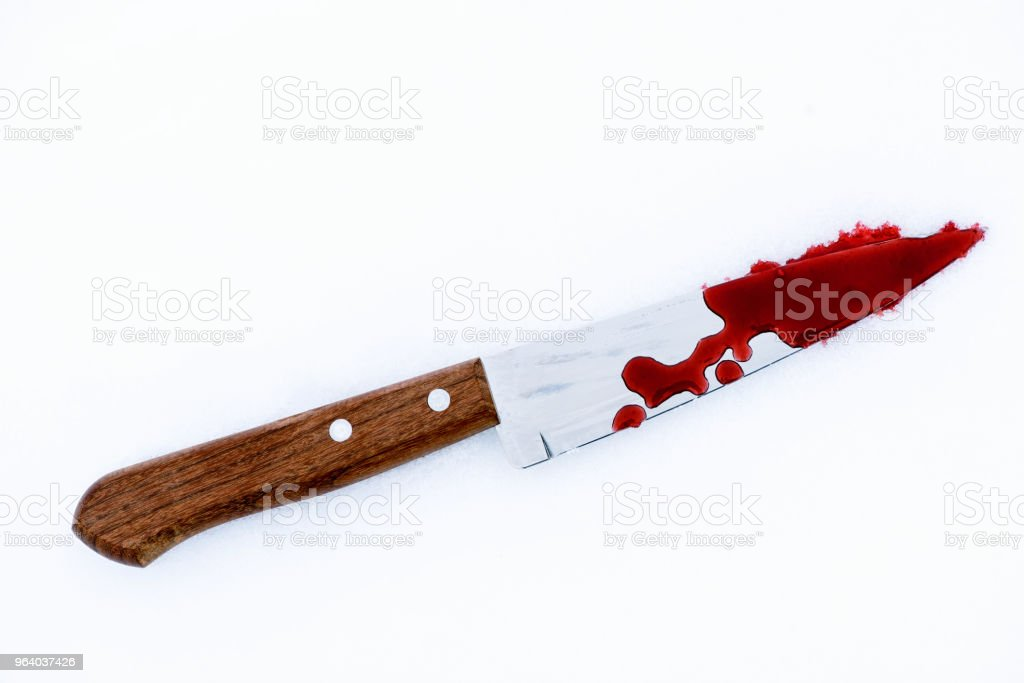 Murder Weapon Knife with Blood Splats and Drops on Snow - Royalty-free Blade Stock Photo