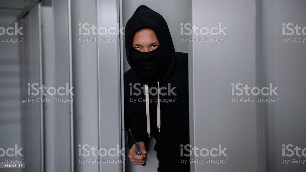 murderer or thief man with knife in toilet stock photo