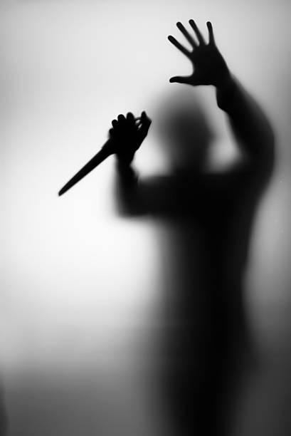 Assassino - foto de acervo