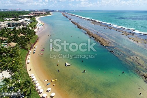 Aerial view of Muro Alto's Beach, Porto de Galinhas, Brazil: Vacation in the paradisiac beach with fantastics natural pools. Great beach view. Travel destination. Vacation travel. Harbor of Chickens, a tourist point of Pernambuco, Brazil.
