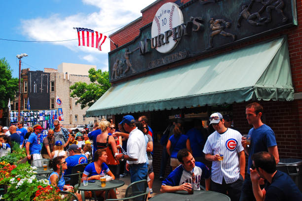 Murphy's, near Wrigley Field in Chicago Chicago, IL, USA May 29, 2012 Fans celebrate a Cubs win at Murphy's, a tavern outside of Wrigley Field in Chicago major league baseball stock pictures, royalty-free photos & images