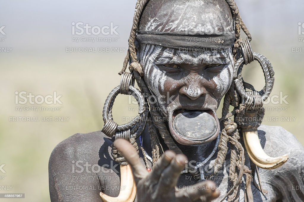Mursi woman with a strange lip plate stock photo
