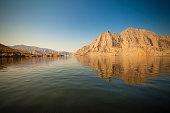 golden rocks at musandam fjords at the street of hormuz, gourvernaute sultanate of oman.