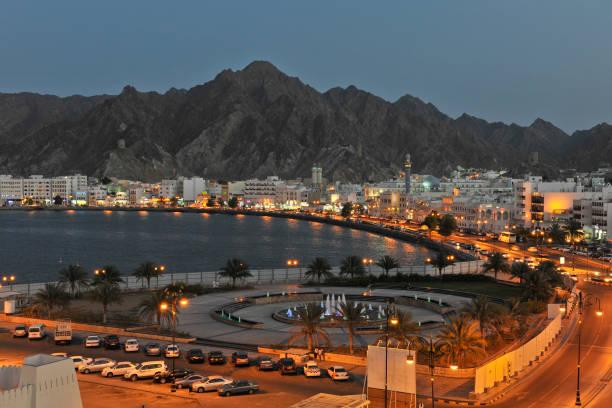 muscat city at night - oman стоковые фото и изображения