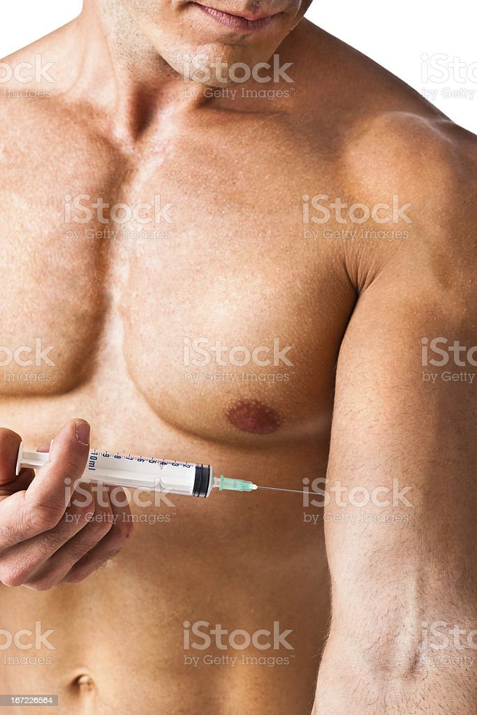 Muscle and syringe royalty-free stock photo