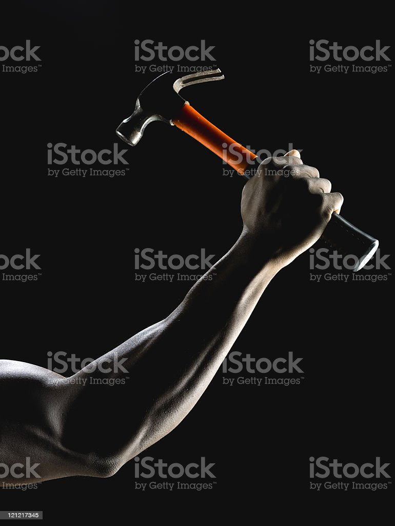Muscle arm holding a hammer stock photo