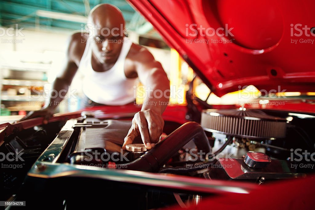 muscle car owner working on vintage vehicle royalty-free stock photo