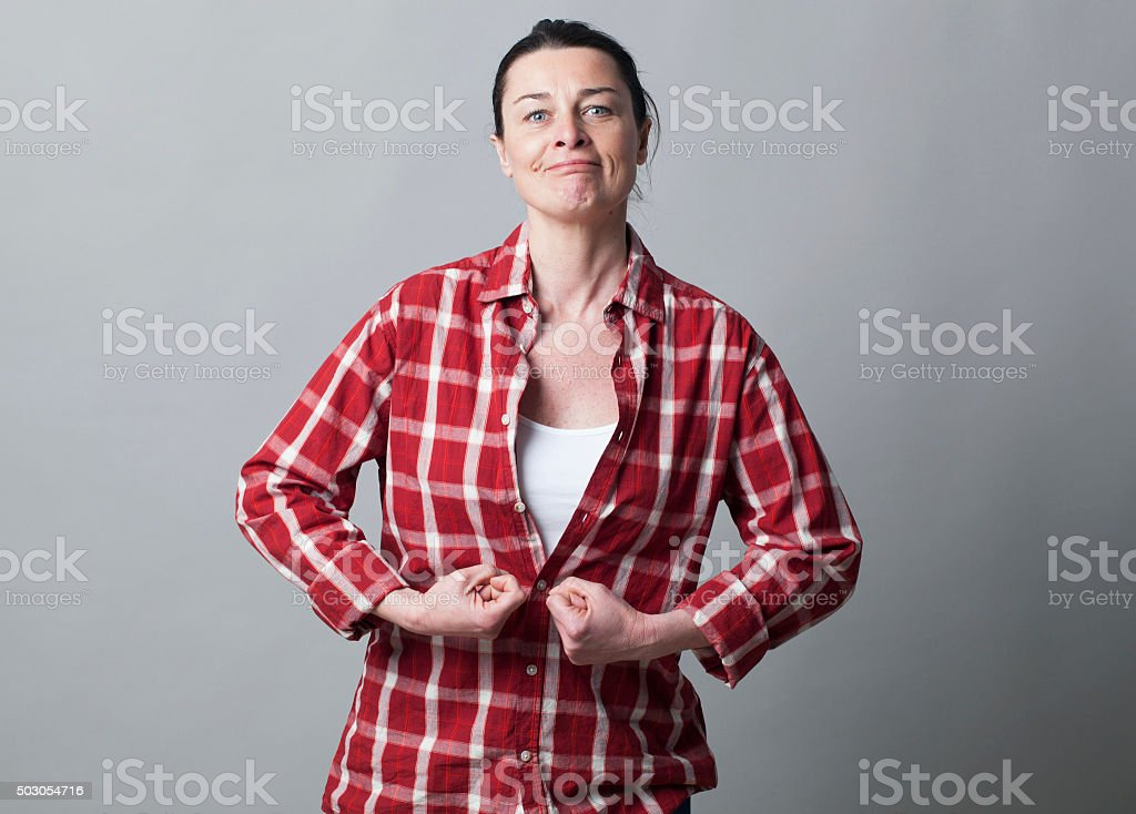 muscle concept for dynamic 40s woman stock photo