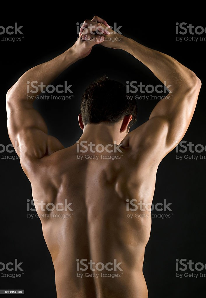 Muscle hispanic man from behind royalty-free stock photo