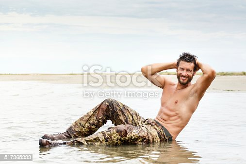 519676858istockphoto Muscle man during fitness training on the water ocean 517365333