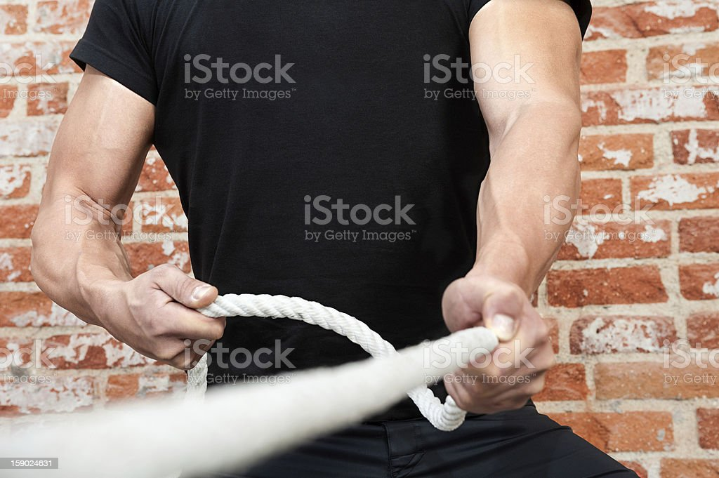 Muscle Man Pulling a Rope stock photo