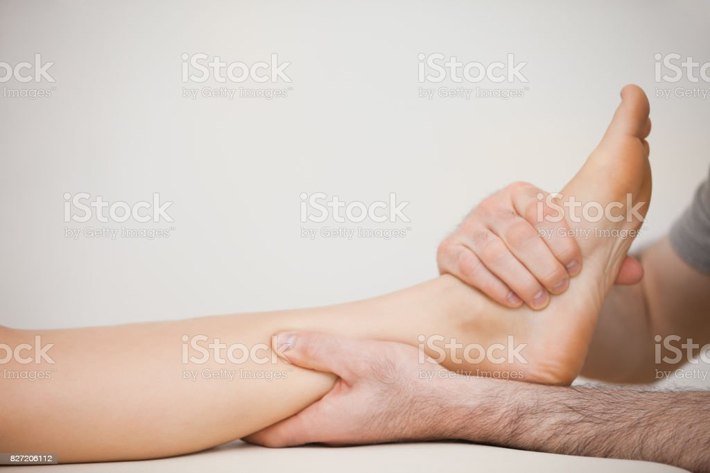 Muscle of a foot being massaged stock photo