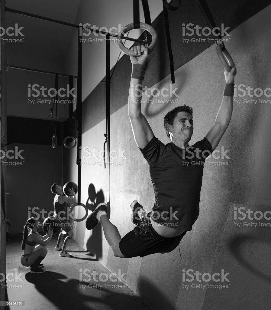 Muscle ups rings man swinging workout at gym royalty-free stock photo