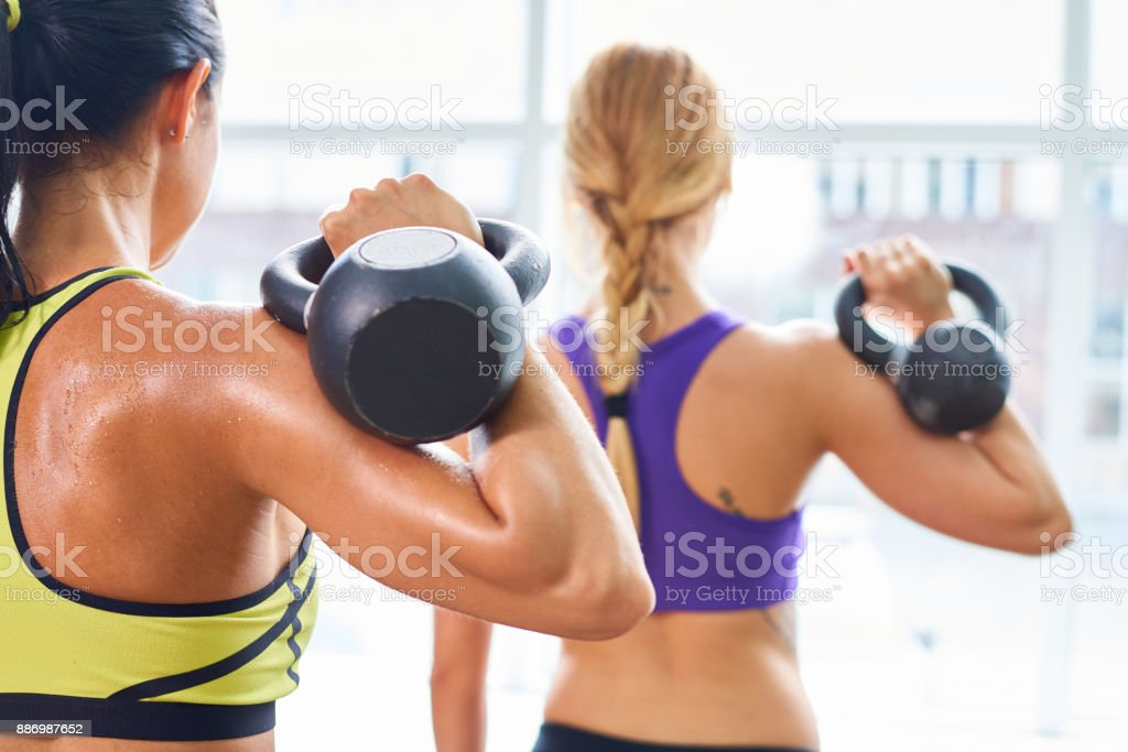 Muscled backs of women stock photo