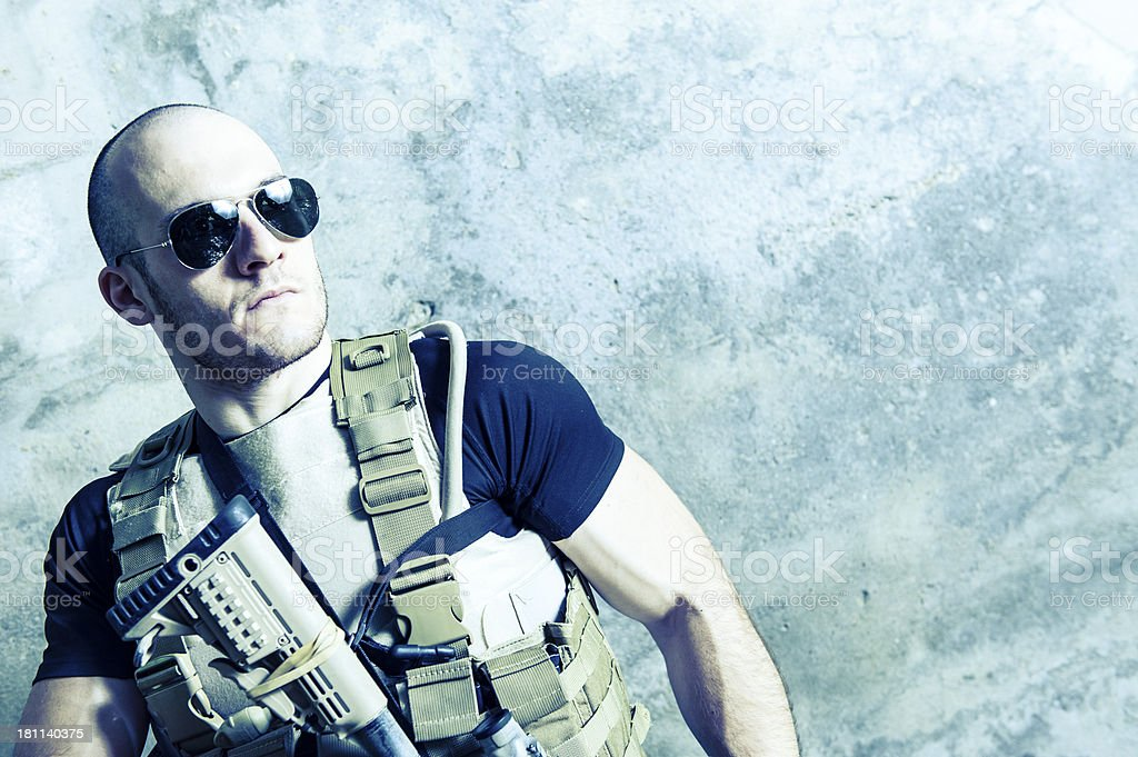 Muscled Handsome Modern Hero Soldier Holding M4 Rifle stock photo