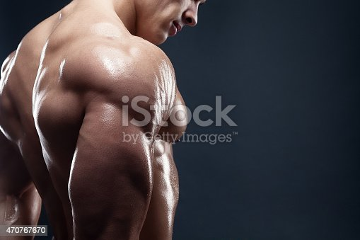 618638418istockphoto Muscled male model showing his back 470767670