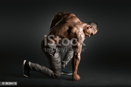 istock Muscled male model showing his back 618638418