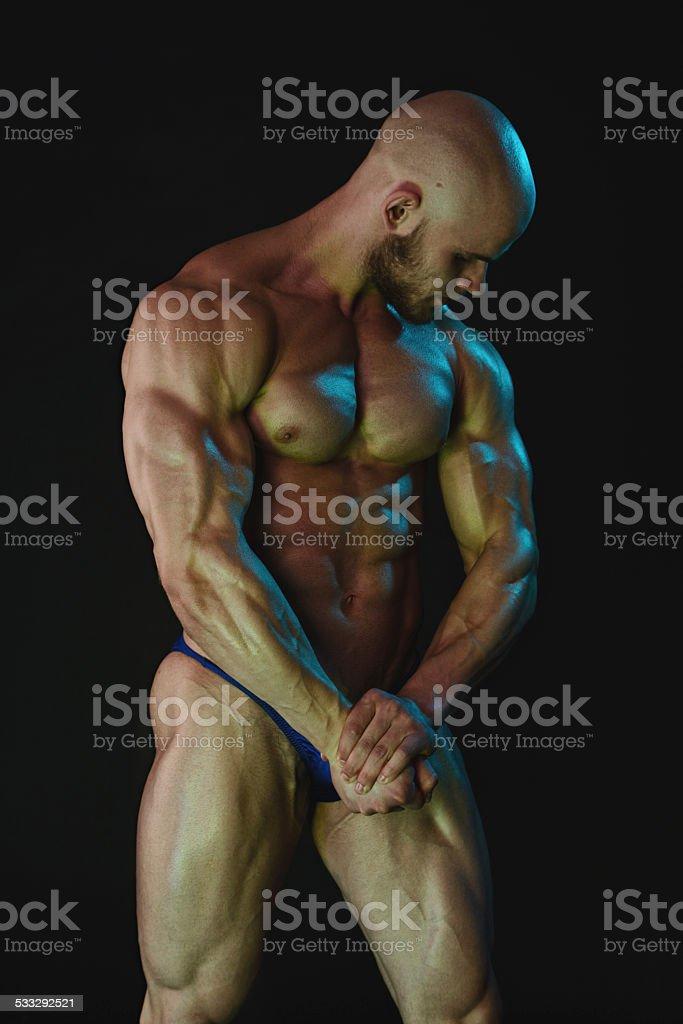 Muscled male torso in studio stock photo